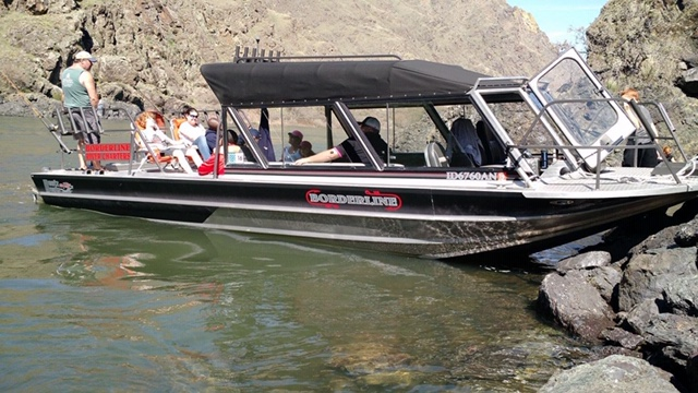 borderline river charters boat moored at the bank of the Snake River